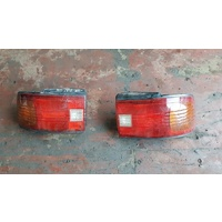 Mazda 323 Tail lights both sides left and ride in stock