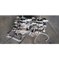 Twin down draft carburettor set model unknown