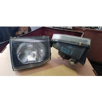 Mitsubishi Pajero 92 front head light set left right E20236