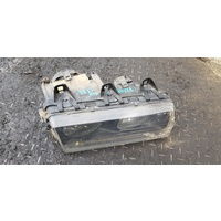 BMW E36 right front head light lamp 1 piece E20328