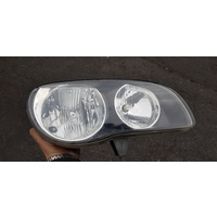 Toyota Corolla AE112 right side front head light lamp E20302