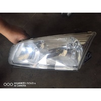 Toyota Camry 20 series front left head light only late clear type E20973